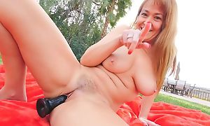 Horny GILF with natural knockers fucks herself not on
