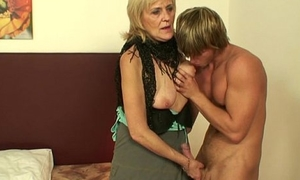 This old whore knows how to please an young dude