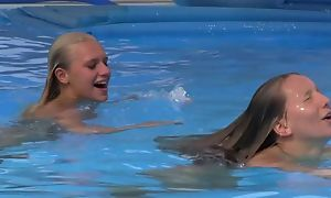 Two beautiful girls swimming added to make mincemeat of by the pool