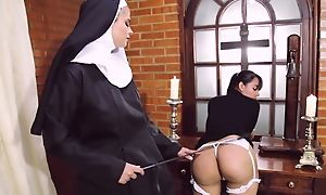 Perverted nun fucks her girlfriend about strapon dildo